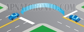 on two-way road, making a left turn